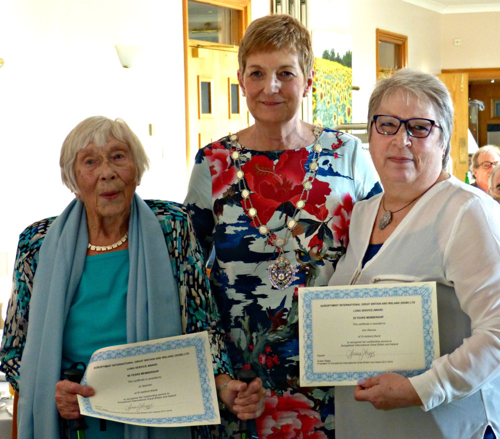 Federation President Sue gives long service awards to Jo Spencer and her daughter Ann Reeves Jo has been a Soroptimist for 50 years and Ann for 25